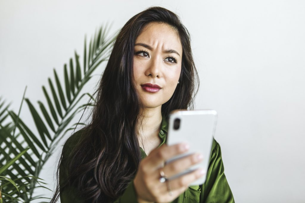 Confused woman reading a text