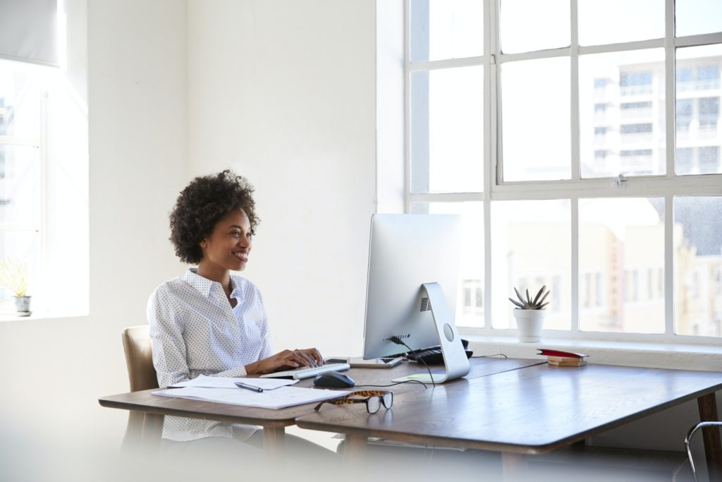 Young black woman working at computer in an office
